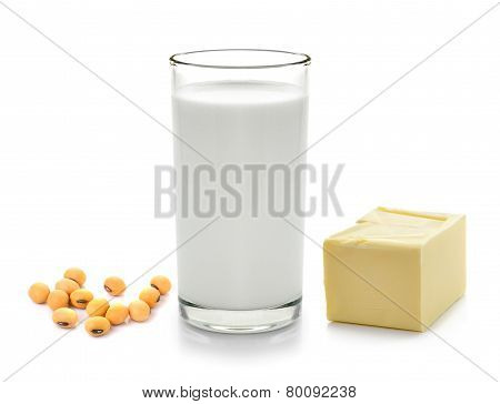 Milk With Soy Beans Stick Of Butter On White Background