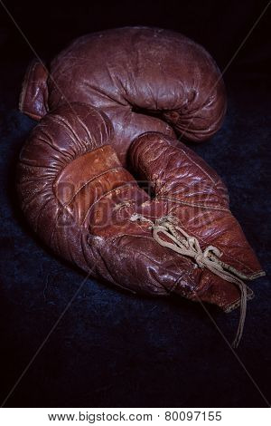 Old leather boxing gloves circa 1930.
