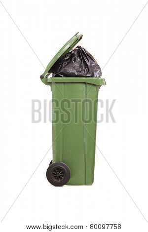 Studio shot of a trash can full of garbage isolated on white background
