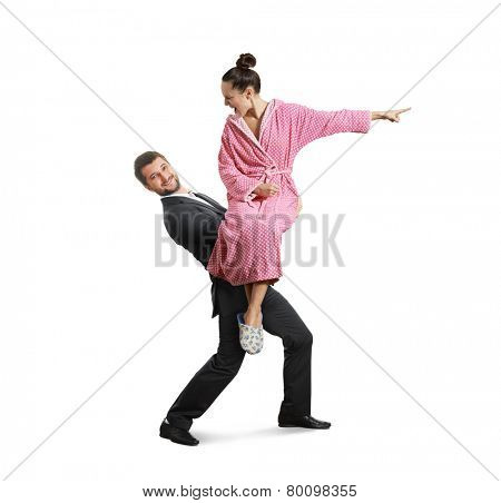 Smiling man carrying a screaming, discontented woman. isolated on white background