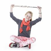image of flute  - young girl with red hair and freckles holding flute in studio against white background - JPG