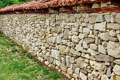 stock photo of old stone fence  - Natural stone fence - JPG
