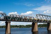 image of railcar  - Petrivskiy railroad bridge in Kyiv across the Dnieper with freight train on it - JPG