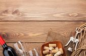 pic of wooden table  - Red wine bottle - JPG