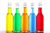 pic of alcoholic beverage  - Colorful alcoholic beverages in glass bottles isolated on white - JPG