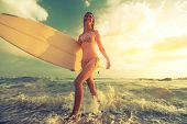 picture of board-walk  - Surfer girl walking with board on the sandy beach - JPG