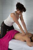 pic of thai massage  - Woman lying on mat receiving massage from thai therapist - JPG