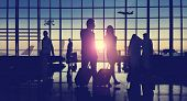 stock photo of skyscrapers  - Back Lit Business People Traveling Airport Passenger Concept - JPG