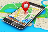 stock photo of gps navigation  - Macro view of modern black glossy touchscreen smartphone or mobile phone with wireless navigator map service internet application on screen and red destination pointer marker icon on city map with selective focus effect - JPG