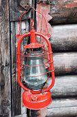 foto of kerosene lamp  - Kerosene lamp on wooden door background - JPG