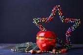 stock photo of hazelnut tree  - Red apple stuffed with dried fruits with cinnamon - JPG