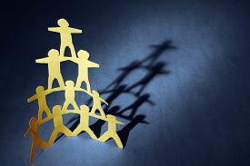pic of human pyramid  - Human team pyramid on blue background - JPG