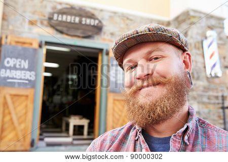 Portrait Of Hipster Barber Standing Outside Shop