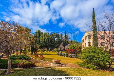 Church Sermon on the Mount - Mount of Beatitudes. Lovely park lit afternoon sun. Subtle shade of palms and cypresses