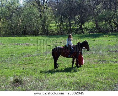 Girl Sitting On A Horse