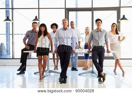 Coworkers posing to camera in meeting room