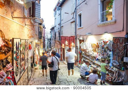 Tourists Walking Next To Displayed Souvenirs In Rovinj