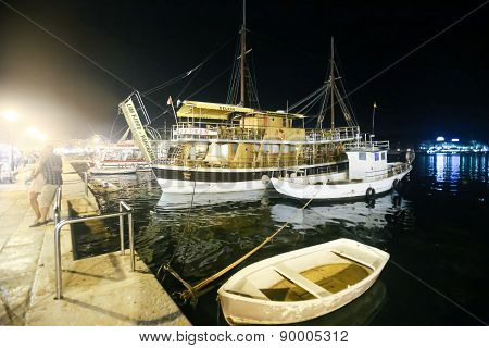 Moored Boats In Rovinj At Night