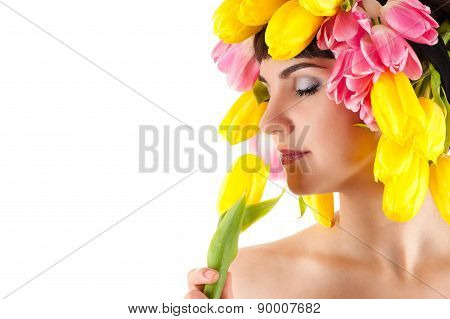 sensual woman smelling a tulip