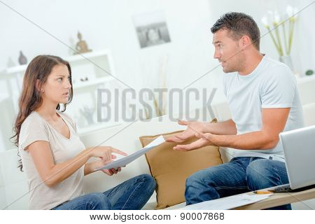 Couple arguing over bills