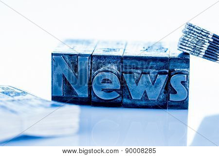 the word news written with lead letters. symbolic photo for newsletters, newspapers and information