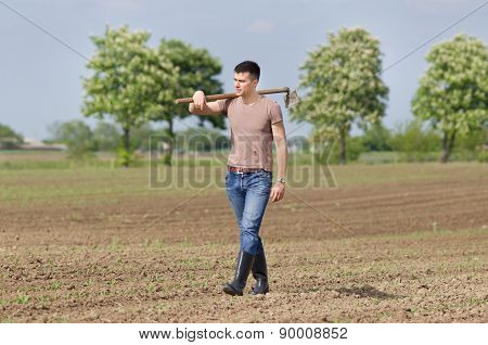 Farmer With Hoe