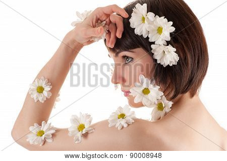 beautiful face of woman with flowers chrysanthemums