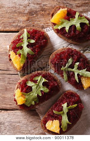 Bread With Beetroot, Oranges And Rucola. Top View Vertical