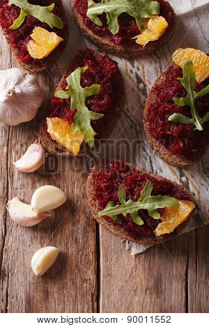 Canape With Beets, Oranges And Rucola. Top View Vertical