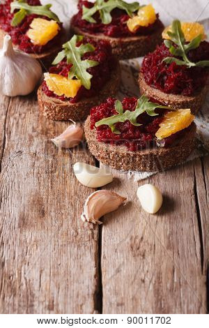 Sandwich With Beets, Oranges And Rucola Close-up. Vertical
