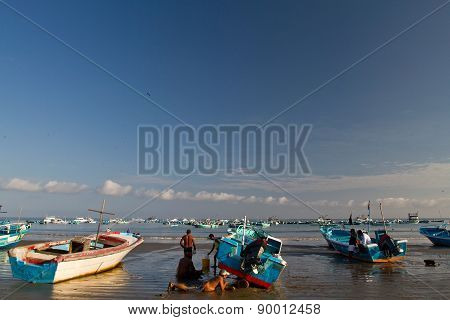 Fishermen boats  along a beach shore, Puerto Lopez, Ecuador