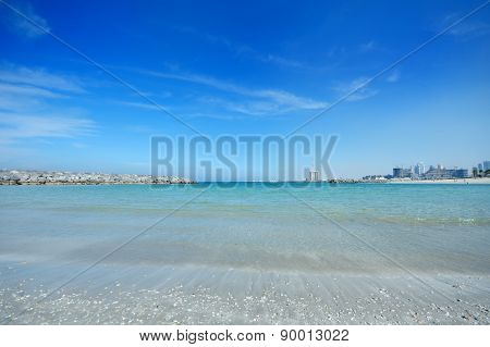 Beautiful Sea Shore And Modern City Built On The Horizon