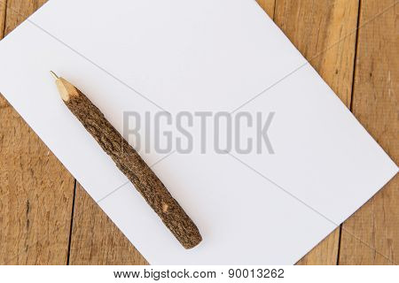 letter, message, mail and  inspiration concept - white blank paper sheet with wooden pen on table