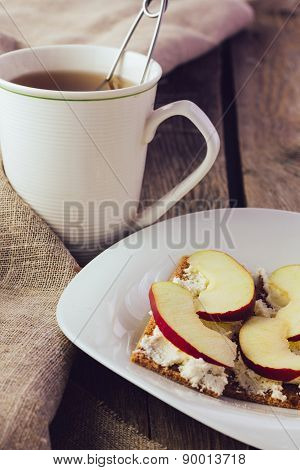 Crisp Bread With Cream Cheese And Apples And Cup Of Tea