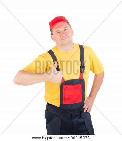 Worker wearing overalls.