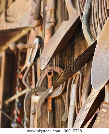 A Rustic Wooden Wall Of Rusty Tools