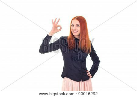 Happy successful redhead woman showing OK sign