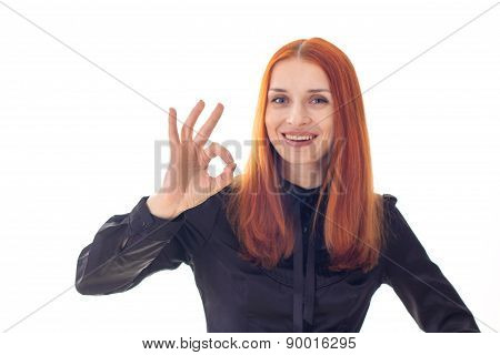 Portrait of successful young laughing woman with ok sign