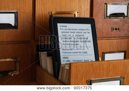 E-book Reader In Library Catalog Card Drawer - New Technology Concept