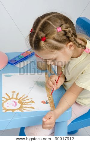 Six Year Old Girl Draws A Paint Something In The Picture