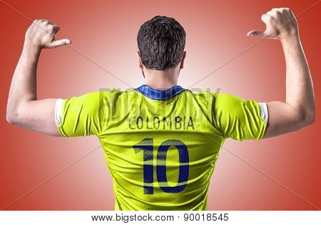 Colombian soccer player on red background