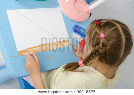 Girl Draws On The Ground Below