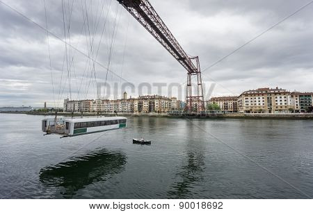 Ultra Wide view closeup of the Bizkaia suspension bridge and boat