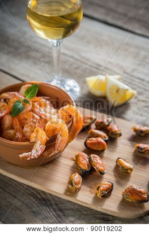 Fried Shrimps And Mussels With Glass Of White Wine