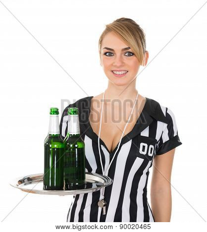 Female Referee With Drinks On Tray