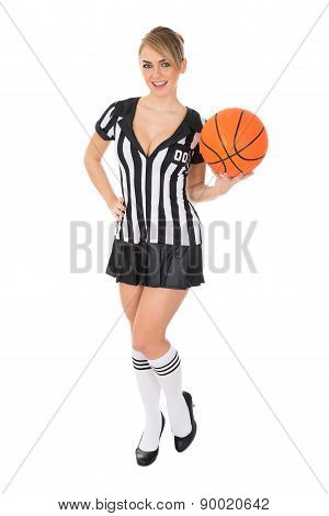 Female Referee Holding Basketball
