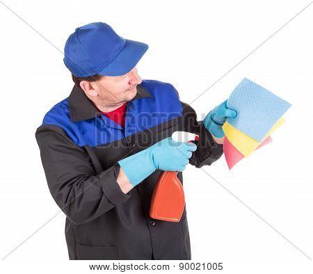 Man holds spray bottle and sponge.
