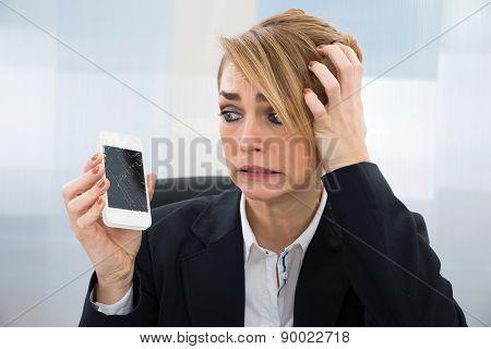 Businesswoman Holding Broken Smartphone