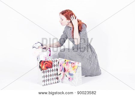 Woman looking at shopping bags
