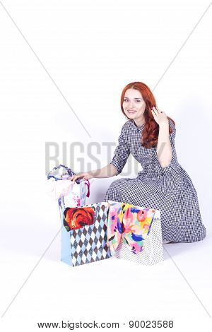 Smiling woman contemplates gift bags